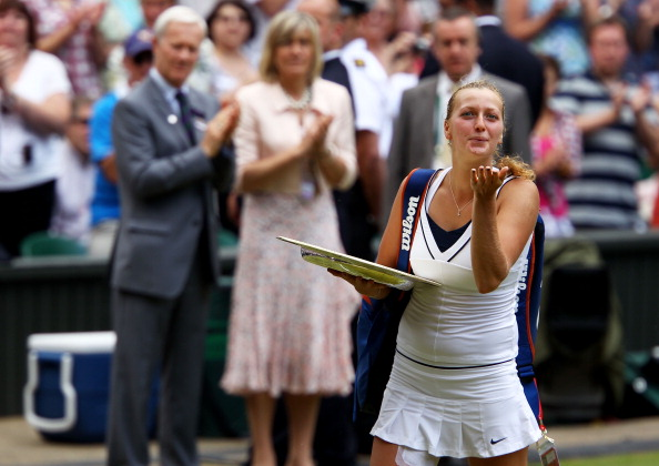 Kvitova bids a goodbye kiss to the crowd after the trophy presentation ceremony in 2011 where she won her first Grand Slam title. Photo credit: Clive Brunskill/Getty Images.