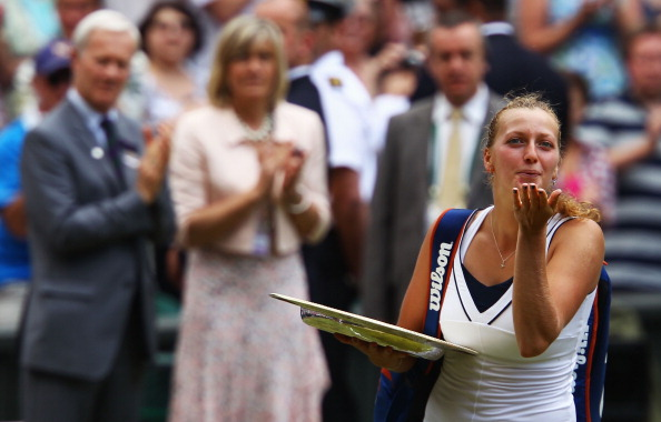 Kvitova holds her first Grand Slam trophy, the Venus Rosewater Dish as she bids a kiss goodbye to the crowd after the conclusion of the 2011 ladies' final. Photo credit: Clive Brunskill/Getty Images.