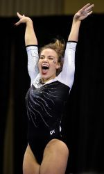 Mary Beth Box celebrates a big floor routine at the NCAA Women's Gymnastics Championships/Georgia Bulldogs