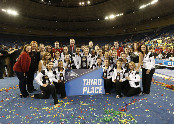 Alabama celebrates their third place finish at the NCAA Women's Gymnastics Championships/Alabama Athletics