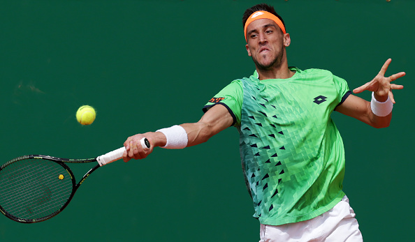Damir Dzumhur hitting a return (Photo: Jean-Christophe Magnenet/Getty Images)
