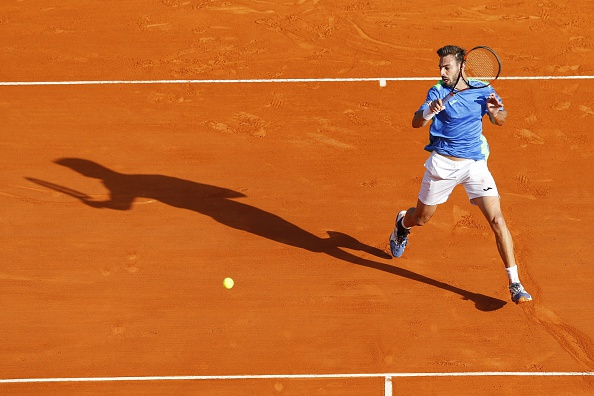 Marcel Granollers returns the ball to Gael Monfils (Photo: Valery Hache/Getty Images)