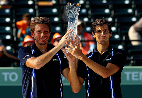 Pierre-Hugues Herbert and Nicolas Mahut of France pose with the Butch Buchholz Trophy (Photo:Mike Ehrmann/Getty Images)