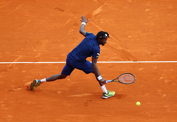 Gael Monfils plays a backhand during the singles final match against Rafael Nadal (Photo: Michael Steele/Getty Images)