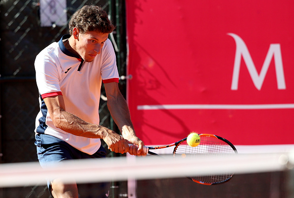 Pablo Carreno Busta in action during his doubles match at he Millenium Estoril Open (Photo: Gualter Fatia/Getty Images)