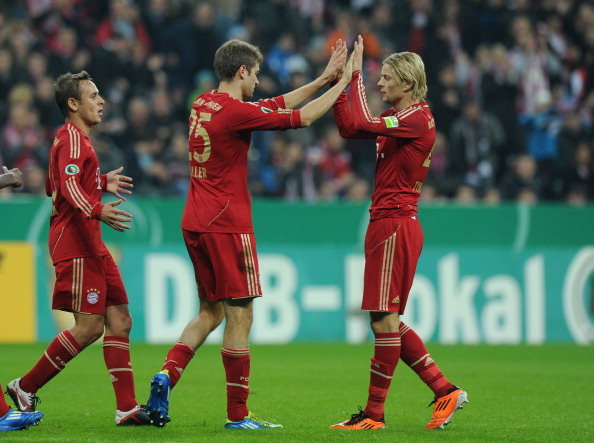 Anatoliy Tymoshchuk (right), pictured here celebrating with Thomas Müller in 2011, will come up against several former Bayern Munich teammates tomorrow.