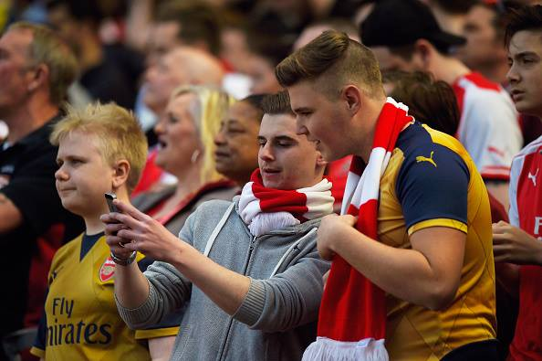 Arsenal fans finding the news from Newcastle. | Source: Mike Hewitt/Getty Images