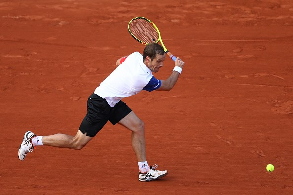 Gasquet hitting a backhand. Photo: Julian Finney / Getty Images