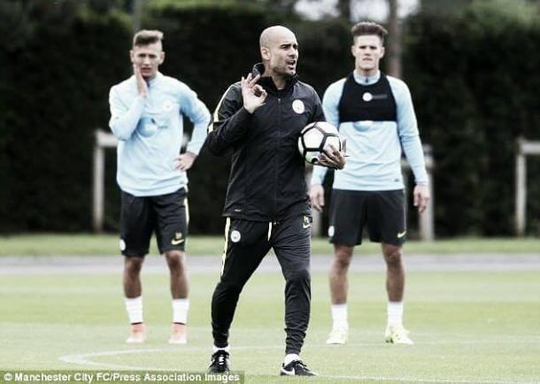 Above: Pep Guardiola taking charge of a Manchester City training session | Photo: Manchester City FC/Press Association Images