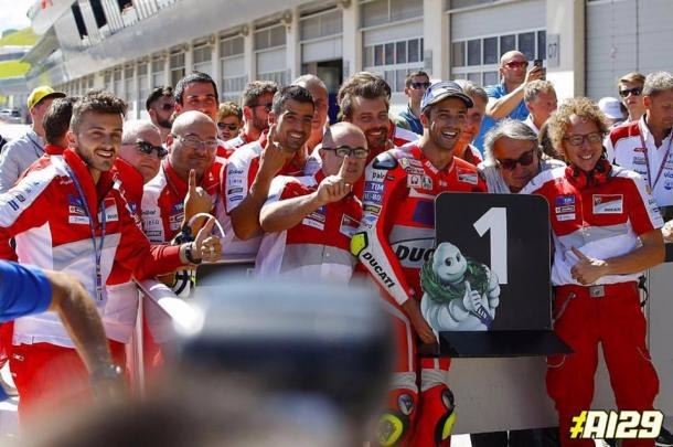Iannone in parc ferme with his Ducati Team celebrating pole position for the first Austrian GP in 19 years - www.facebook.com (Andrea Iannone)
