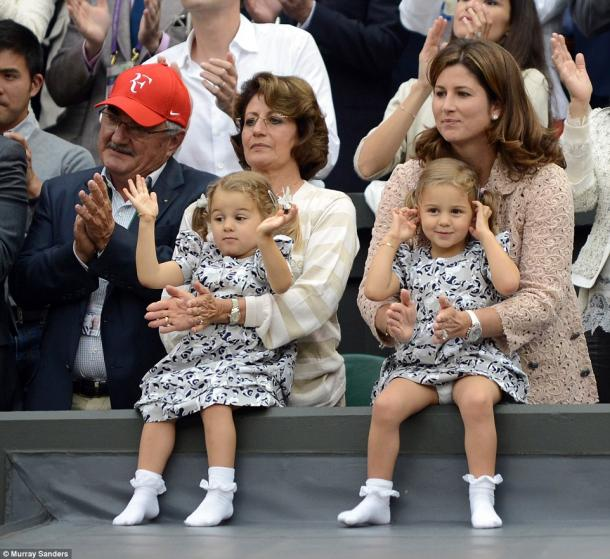 Federer's family often travels with the superstar. As shown here, his father, mother, wife and two daughters celebrate Federer's 2012 Wimbledon victory. Credit: Murray Sanders