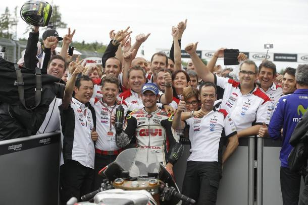 Celebrating with the LCR Team in parc ferme after the race - www.facebook.com (Cal Crutchlow)