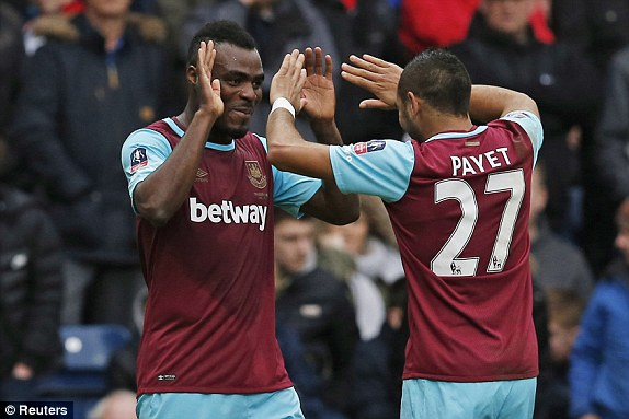 Emmanuel Emenike celebrates a dominant win over Blackburn with Dimitri Payet. (Photo: Reuters)