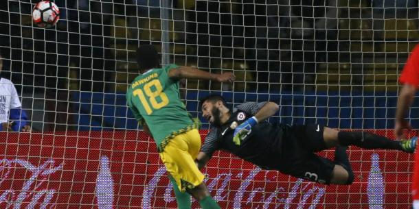 Simon Dawkins drills a shot in Jamaica's 2-1 win over Chile. | Photo: Andres Pina/Photosport