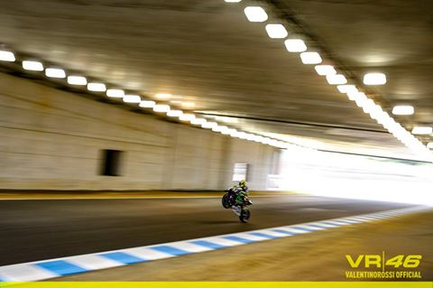 Rossi doing a wheelie through the tunnel in Japan