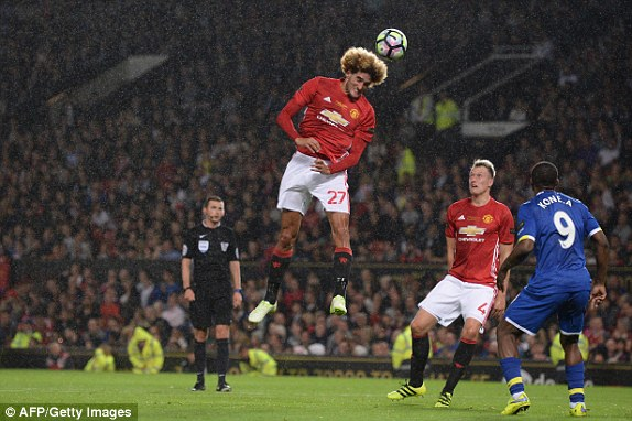 Above: Marouanne Fellaini climbing high in Manchester United's 0-0 draw with Everton | Photo: AFP/Getty Images