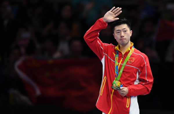 Ma Long acknowledging the crowd after receiving his Olympics Gold Medal | Photo: Xinhua/Lin Yiguang