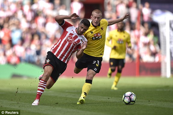 Above: Shane Long been brought down by Ben Watson in Southampton's 1-1 draw with Watford | Photo: Reuters