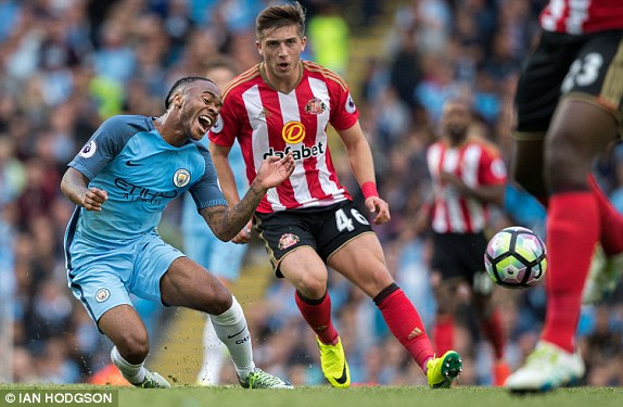 Above: Manchester City's Raheem Sterling been brought down by Sunderland's Lynden Gooch | Photo: Ian Hodgson
