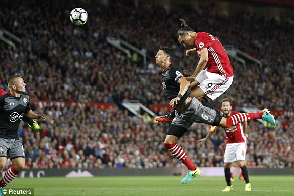 Above: Zlatan Ibrahimovic heading home his first goal in Manchester United's 2-0 win over Southampton | Photo: Reuters