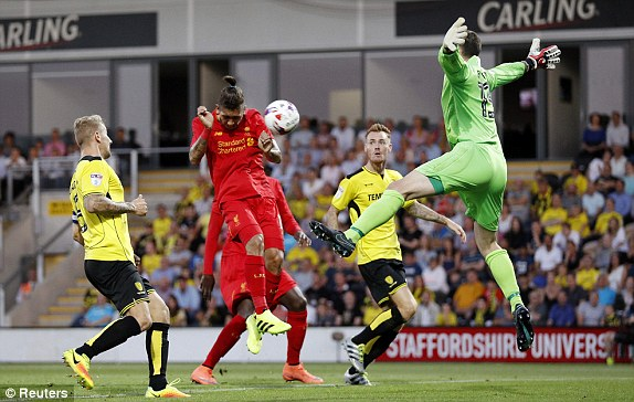 Above: Roberto Firmino heading home Liverpool's second goal in the 5-0 win over Burton Albion | Photo: Getty Images