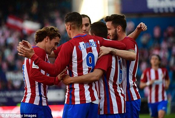 L'Atletico esulta nella vittoria per 3-1 sul Siviglia. | Fonte immagine: Getty via Daily Mail