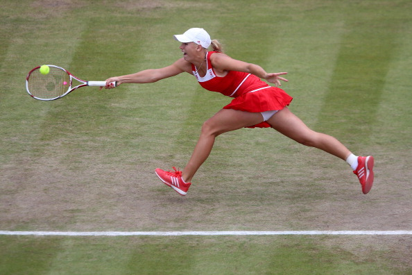 Caroline Wozniacki hits a forehand at the London 2012 Olympics/Getty Images