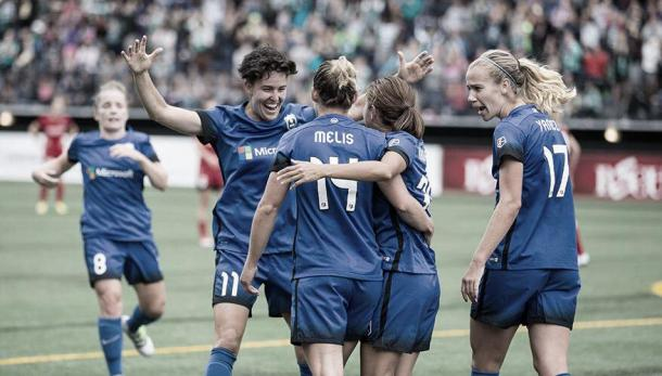 The Reign celebrating with Melis.