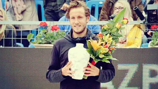Lucas Pouille holds the trophy at the inaugural Hungarian Open in 2017. He will look to defend the title this week. Photo: ATP World Tour