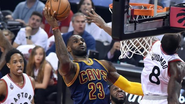 Cleveland Cavaliers' forward LeBron (23) James goes for a layup against Toronto Raptors' center Bismack Biyombo (8) in Game 4