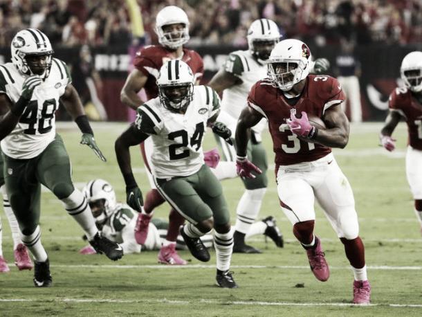 David Johnson runs for a 58-yard touchdown. (Rob Schumacher/azcentral sports)