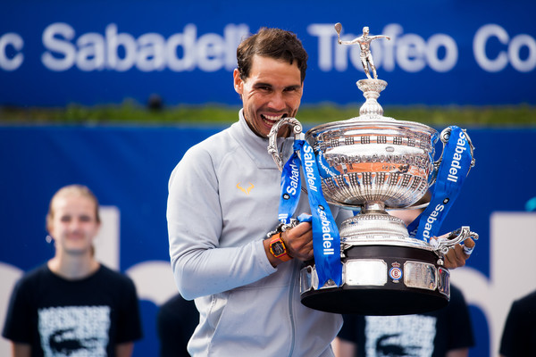 Rafael Nadal bites his 11th Barcelona trophy on Sunday. Photo: Alex Caparros/Getty Images