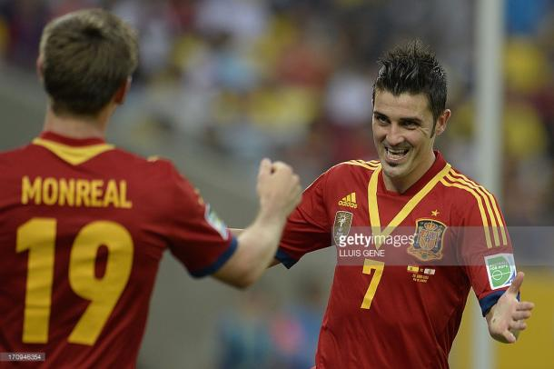 Spain's forward David Villa (R) celebrates with teammate Nacho Monreal after scoring against Tahiti during their FIFA Confederations Cup Brazil 2013 Group B football match, at the Maracana Stadium in Rio de Janeiro on June 20, 2013. AFP PHOTO / LLUIS GENE (Photo credit should read LLUIS GENE/AFP/Getty Images)