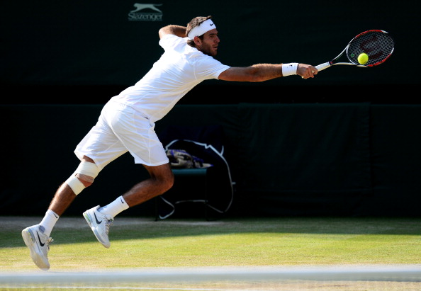 Juan Martin del Potro hits a backhand at Wimbledon 2013/Getty Images