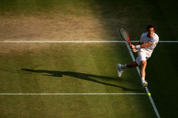 Andy Murray plays a backhand during his semifinal match against Jerzy Janowicz at Wimbledon 2013. (Photo by Clive Brunskill/Getty Images)
