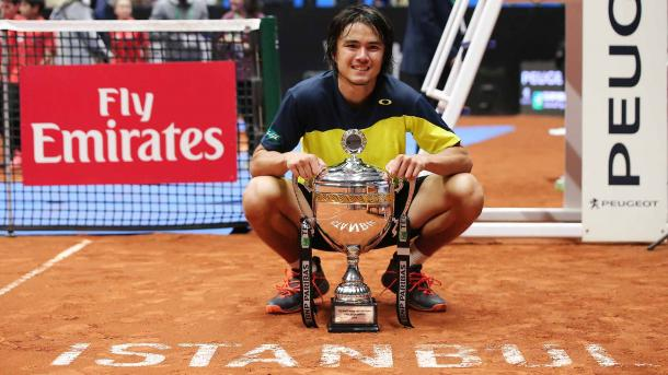 Taro Daniel poses with the first trophy of his career after winning in Istanbul. Photo: Koza World of Sports/ATP World Tour