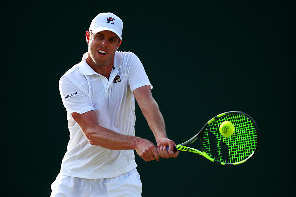 Sam Querrey plays a backhand shot (Photo: Clive Brunskill/Getty Images)