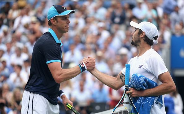Winner Sam Querrey shakes hands with Jordan Thompson at the net (Photo: Alex Pantling/Getty Images)
