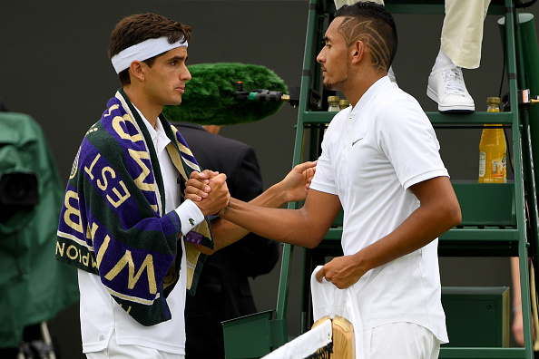 Pierre-Hugues Herbert consoles Nick Kyrgios, who is forced to retire with injury (Photo: Shaun Botterill/Getty Images)
