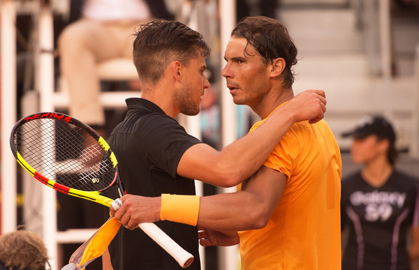 Rafael Nadal (right) embraces Dominic Thiem after his shocking quarterfinal loss which snapped a 21-match clay-court win streak. Photo: Denis Doyle/Getty Images