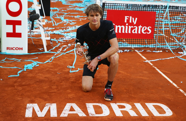 Sascha Zverev poses with the trophy after his victory in Madrid. Photo: Clive Brunskill/Getty Images