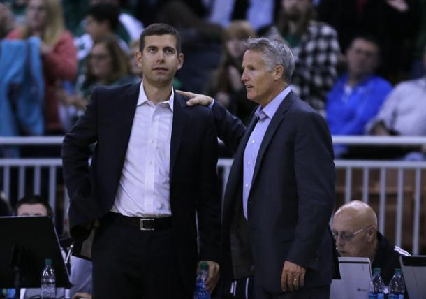 Celtics' coach Brad Stevens (left) and Sixers' coach Brett Brown (right) have a chat during a game (Charles Krupa/AP Photo)
