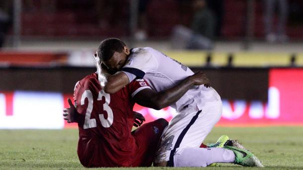 USMNT's Terrence Boyd attempting console Panamanian Felipe Baloy after the 3=2 hear breaking defeat on October 15th, 2013 in the Estadio Rommel Fernandez. Photo provided by Arnulfo Franco-AP Photo.