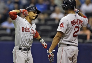 Betts and Bogaerts celebrate a home run in a 2015 game against the Tampa Bay Rays