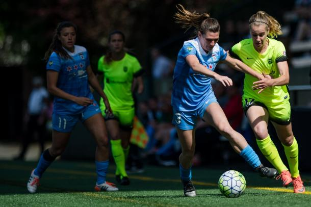 Arin Gilliland of the Chicago Red Stars fights to keep possession when the teams met last season | Source: The Bold
