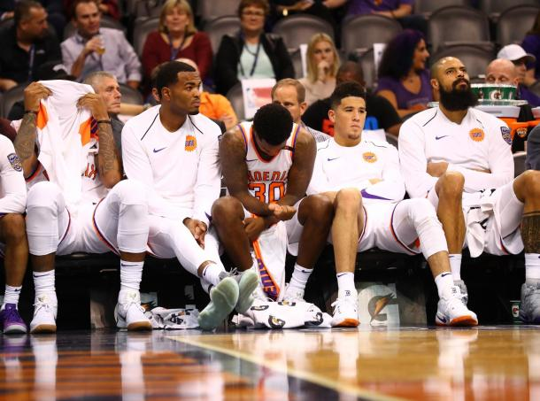 Marquise Chriss and TJ Warren on the bench with their teammates  react on the bench in the fourth quarter against the Portland Trail Blazers at Talking Stick Resort Arena. |Mark J. Rebilas-USA TODAY Sports|