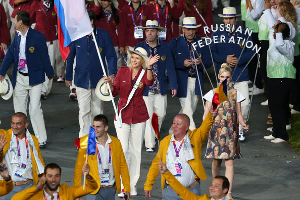 Maria Sharapova proudly carrying the Russian flag | Photo: Alex Livesey/Getty Images Europe