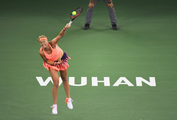 Petra Kvitova hits a serve against Dominika Cibulkova during the final of the 2016 Dongfeng Motor Wuhan Open. | Photo: Greg Baker/AFP