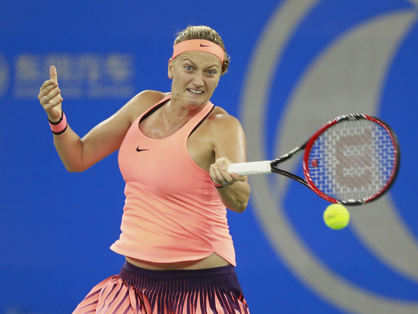 Petra Kvitova hits a forehand against Dominika Cibulkova during the final of the 2016 Dongfeng Motor Wuhan Open. | Photo: Kevin Lee/Getty Images