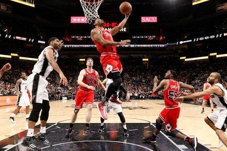 Chicago Bulls point guard Derrick Rose (1) gets past San Antonio Spurs power forward Tim Duncan (21, left) during the second half at AT&T Center. (Credit: Soobum Im-USA TODAY Sports)